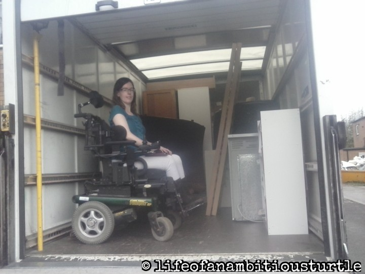 Me in my powered wheelchair sat in the back of a removals van