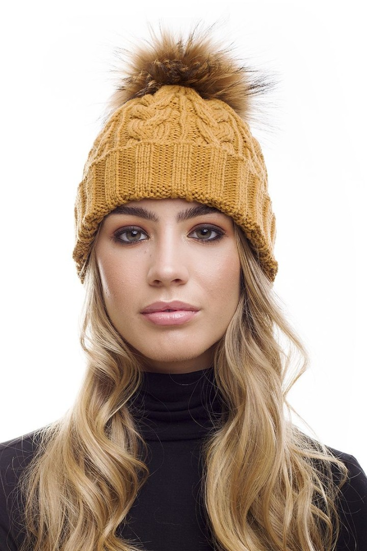 Lady sporting a mustard coloured bobble hat