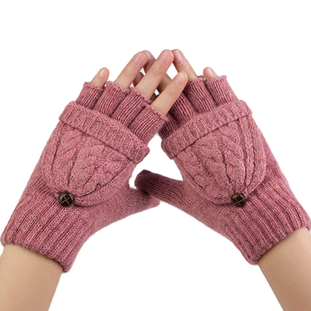 Model sporting knit rose pink mitten gloves with button fastening