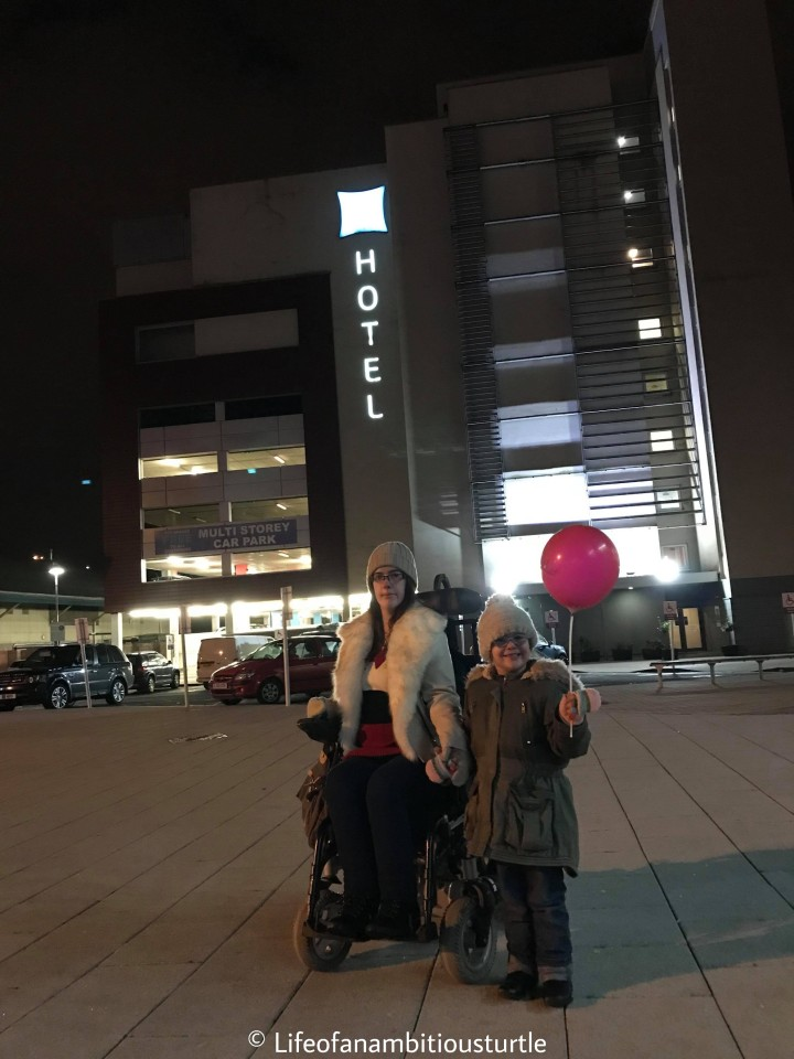 Abbie and I wrapped up warmly infront of the Ibis Hotel lit up at night. It is dark and cold