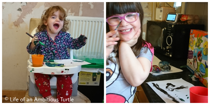 Left - Ava in booster seat covered in paint. Right - Abbie showing off her pebble crafts