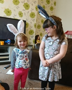 The girls wearing grey and white bunny ear headbands
