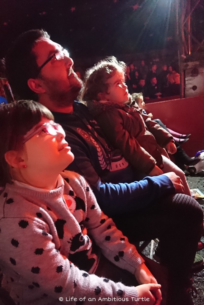 My partner, 6 and 3 year old daughters gazing up in wonder at the performers
