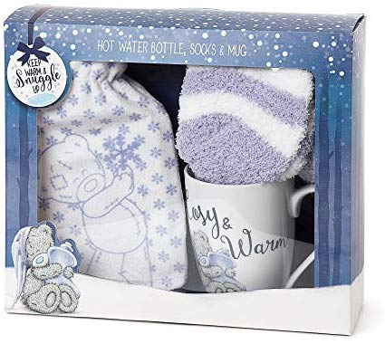 Lilac and white themed boxed gift set featuring tatty Teddy. Inside is a fluffy small hot water bottle, mug and bed socks