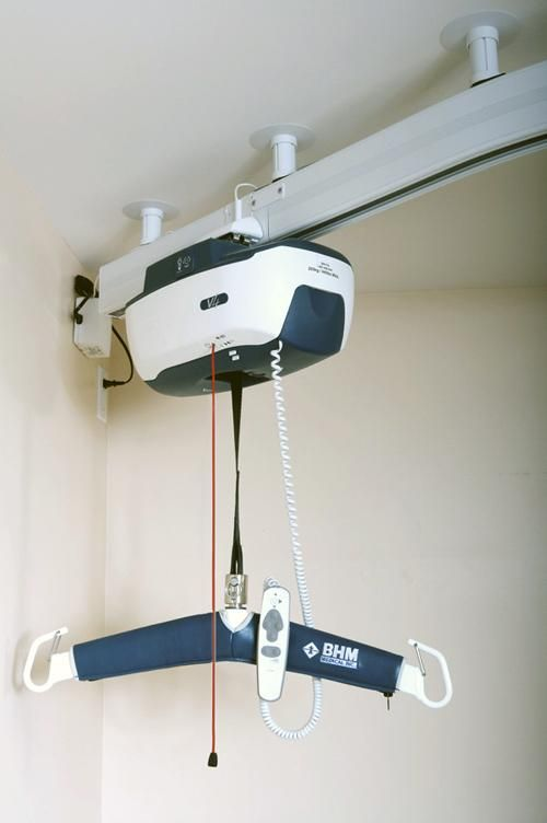 Ceiling track hoist unit stock image with remote
