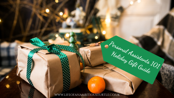 Presents wrapped under a Christmas tree. Presents are in parcel wrap, neutral paper with green ribbon giving a very traditional look. A gift tag hanging off 1 has the blog post title on it.