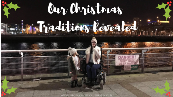 Abbigail and I posing for a photo with the beautiful night landscape of the River Clyde Glasgow behind us. We are wrapped up warmly and I am in my powered whellchair.