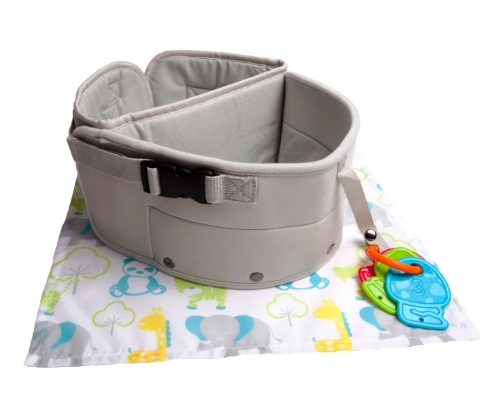 The LapBaby, a grey belted strap that goes around the parents waist, with an additional thick velcro, double buckled strap to go around baby's to secure them to their parents lap. A teether is shown dangling from the loop on the side.